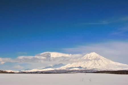 watershed: Volcano with snow in winter day in Russia on Kamchatka Stock Photo