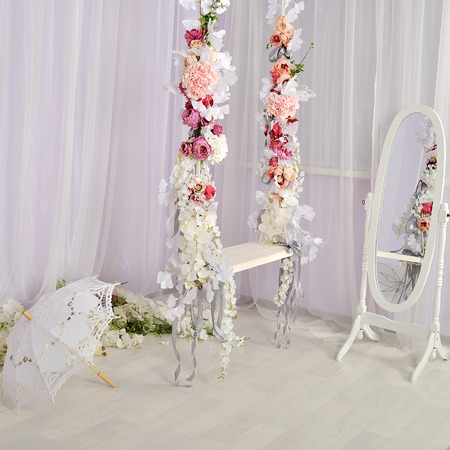 Swing decorated with flowers in white fresh room stock photo stock photo swing decorated with flowers in white fresh room mightylinksfo