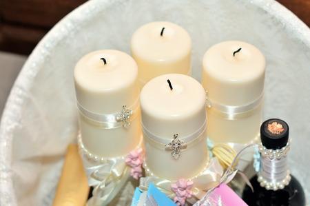 Candles during orthodox christening baptism. Orthodox church