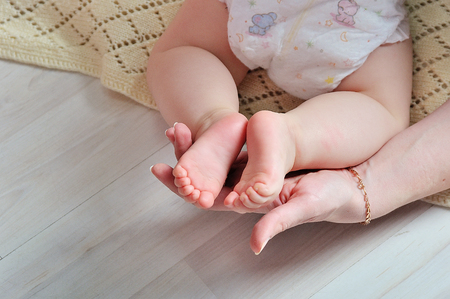 nails: tiny foot of newborn baby in soft selective focus