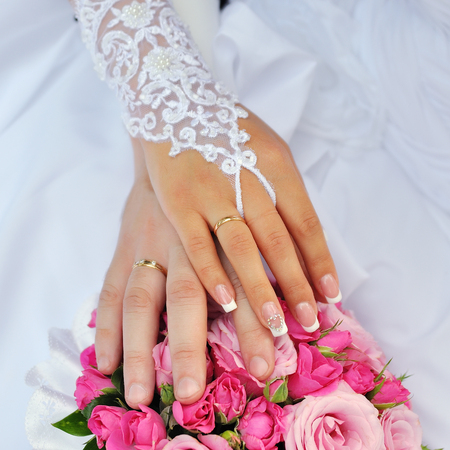 Closeup of a bride and groom hands