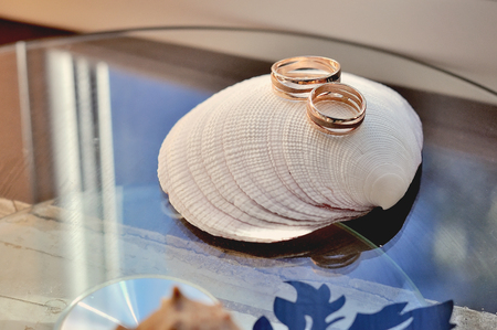 Two golden wedding rings with elegant decorations