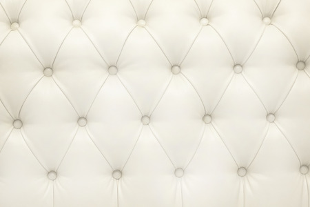 white leather texture: Leather upholstery of a magnificent sofa