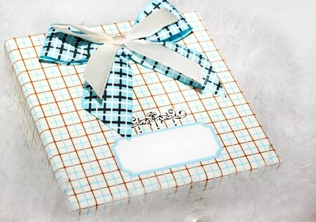 text box: Gift box on a white background, place for text Stock Photo