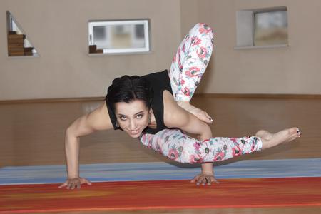 indoors: young fashion women do yoga indoors Stock Photo