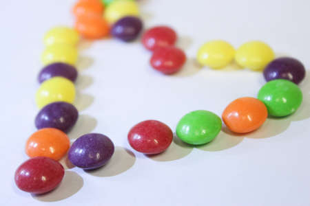 Bright, colored candies on a white background 版權商用圖片