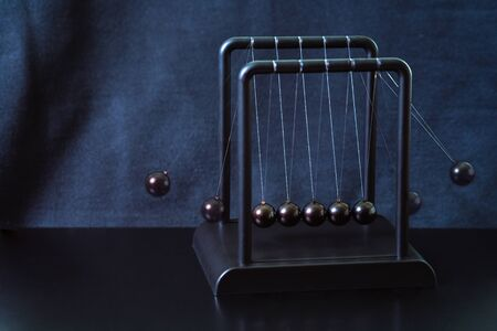 Pendulum balls, great design for any purposes. Perpetual motion. Business concept.