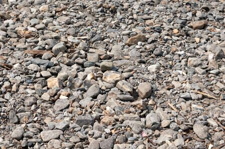 Grey stones at the beach by the lake Como, natural background.