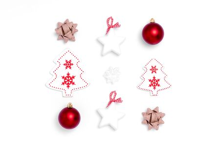 New Year and Christmas composition from red balls, white stars, chrismas tree, deer on white paper background. Top view, flat lay, copy space, square, from above Stock Photo
