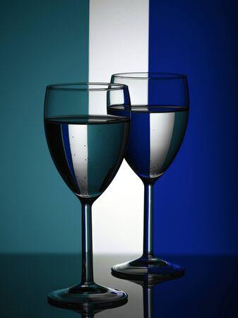 Wine glasses on striped blue and mint background. Trendy color 2020 Reklamní fotografie