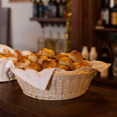 buns in basket - little fresh buns in basket on table