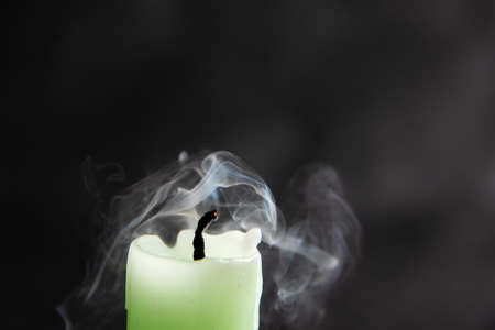 Smoke from a candle on a black isolated background. An interesting and weird smoke pattern.