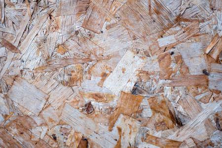 Texture of wood-fiber plate of oversipid sawdust. Top view of OSB wood veneer background, tight, seamless surfaces. 写真素材