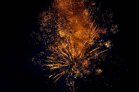Colorful fireworks isolated on a dark background, close up, copy space. Bright yellow and gold sparks on a dark background. Can be used as a festive background 版權商用圖片