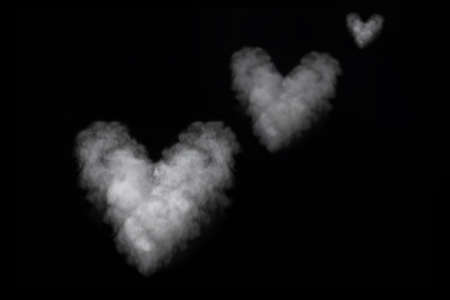 Three white smoke heart shape isolated on black background. Curly smoke for Valentines Day on a dark background. Abstract background, design element