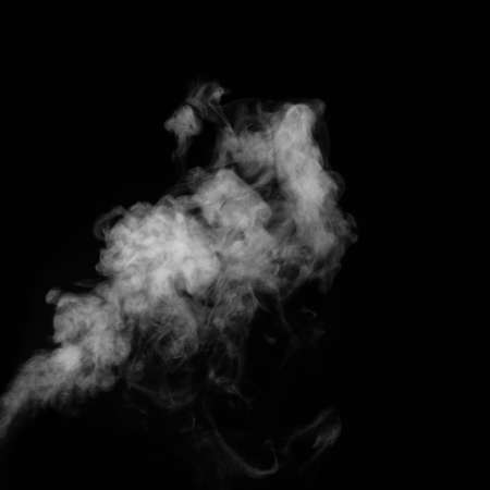 Figured smoke on a dark background. Abstract background, design element, for overlay on picture.