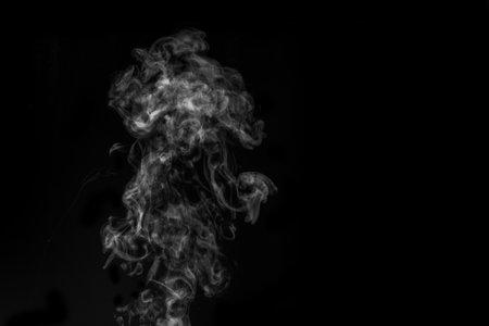 White smoke on black background. Figured smoke on a dark background. Abstract background, design element