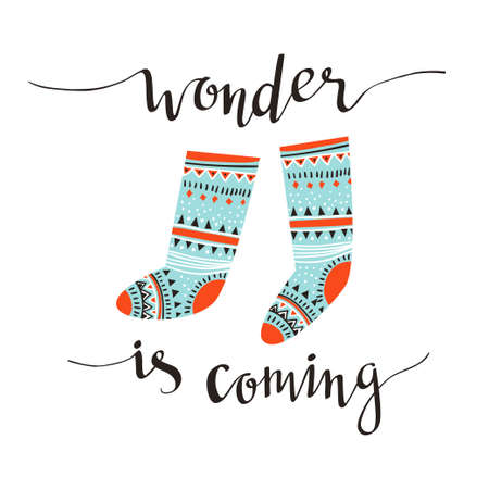Hand-written Christmas lettering and christmas socks for gifts isolated on white background.  Season vector holiday  design with calligraphy - Wonder is coming. Ilustração