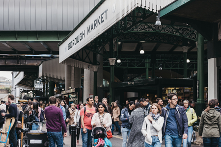 People by the entrance of Borough Market, one of the largest and oldest food markets in London.