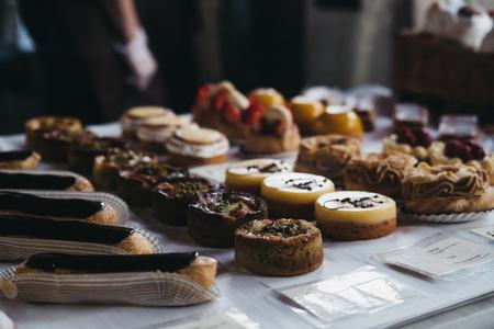 Homemade desserts on sale at Borough Market, London, UK.