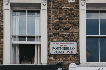 Street name sign on a side of a terraced house in Portobello Road, Notting Hill, London, UK.