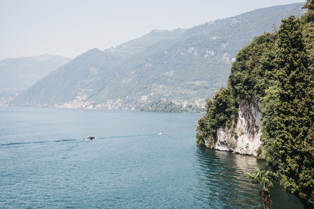 Unidentified boats on Lake Como, Italy, on a bright summer day. Stock Photo