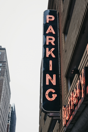 New York, USA - May 31, 2018: Neon sign outside Battery Parking Garage in Battery Park, an area located at the southern tip of Manhattan Island in New York City facing New York Harbour.