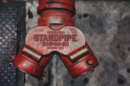 New York, USA - May 28, 2018: Close up top view of a red fire hydrant on a street in New York, USA. Red fire hydrants became an icon of the city streets. Editorial