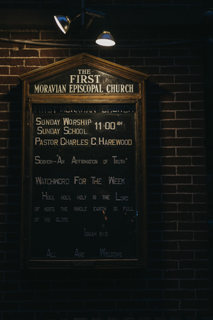 New York, USA - May 29, 2018: Information and quotes on an illuminated board outside the First Moravian Church on Lexington Avenue, New York. The Church has been at the present location since 1869. Editorial