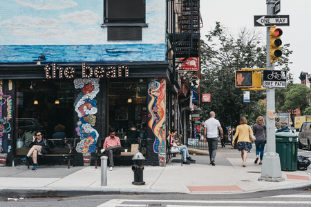 New York, USA - May 28, 2018: People walking on a street in Lower East Side, New York, USA.  New York is one of the most visited cities in the world. Editorial
