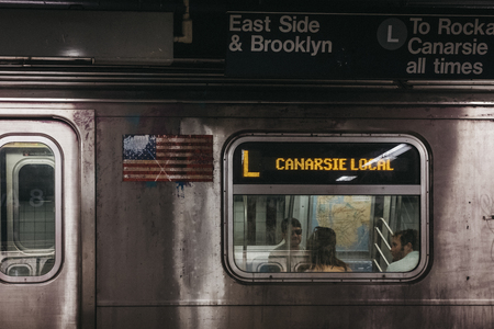 New York, USA - June 2, 2018: Canarsie Local direction announcement on L Line train in New York, USA. New York City Subway is one of the world's oldest public transit systems.