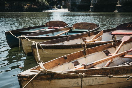 London, UK - August 1, 2018. Richmond Bridge Boat Hire wooden boats moored on the River Thames in Richmond, a suburban town in south-west London famous for a large number of parks and open spaces. Editorial