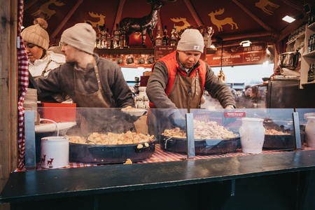 Vienna, Austria - November 25, 2018: Staff cooking food at a stand Christmas and New Years Market at Schönbrunn Palace, one of the most important architectural monuments in Austria.