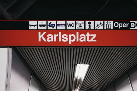 Vienna, Austria - November 25, 2018: Station name sign and directions inside Karlsplatz station in Vienna. Vienna public transport, Wiener Linien, operates five underground lines. Editorial