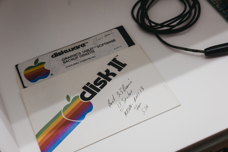 Prague, Czech Republic - August 28, 2018: Signed Apple software backup disk with instructions inside Apple Museum in Prague, the largest private collection of Apple products around the world. Redakční