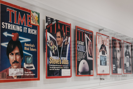Prague, Czech Republic - August 28, 2018: Time magazines with Steve Jobs on the cover inside Apple Museum in Prague, the largest private collection of Apple products around the world.