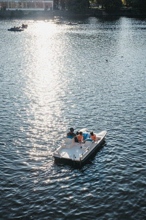 Prague, Czech Republic - August 23, 2018: Family on a paddle boat on Vltava river in Prague on a sunny summer day. Vltava is the longest river within the Czech Republic.