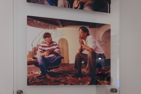 Prague, Czech Republic - August 28, 2018: Signed portrait of Steve Jobs and Bill Gates on exhibit inside Apple Museum in Prague, the largest private collection of Apple products around the world.