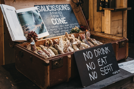 London, UK - January 13, 2019: Saucissons on sale at Mercato Metropolitano, sustainable community market in London focused on revitalising the area and protecting environment.