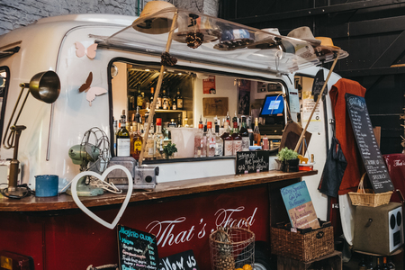 London, UK - November 2, 2018: Bar and drinks truck stand in Mercato Metropolitano, the first sustainable community market in London focused on revitalising the area and protecting environment.