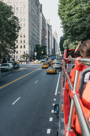 New York, USA - May 31, 2018: View of Central Park West from tourist bus. The street is a part of Central Park West district added to the National Register of Historic Places on November 9, 1982.v