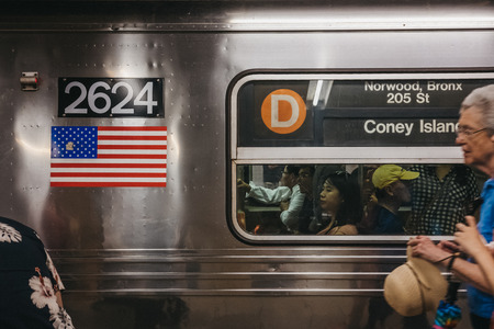 New York, USA - June 2, 2018: Coney Island direction announcement on D Line train in New York, USA. New York City Subway is one of the worlds oldest public transit systems. Editorial