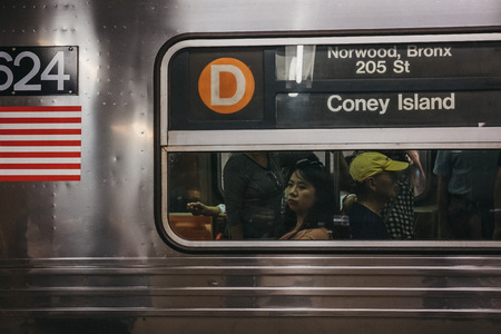 New York, USA - June 2, 2018: Coney Island direction announcement on D Line train in New York, USA. New York City Subway is one of the world's oldest public transit systems. Banco de Imagens - 117654704