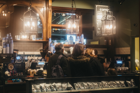 London, UK - January 26, 2019: People queuing inside Cafe Nero, a British European style coffee house brand headquartered in London, England, UK.