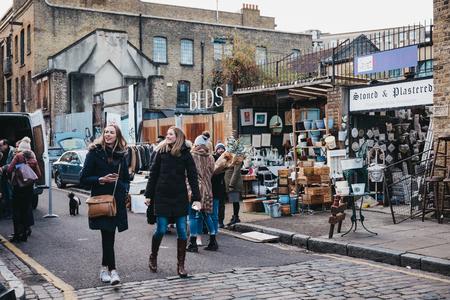 London, UK - February 3, 2019: People walking on Erza Street near Columbia Road Flower Market, a street market in East London that is open every Sunday.