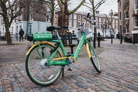 London, UK - February 16, 2019: Dockless Lime E electric bike on a street in Primrose Hill, London. Bike sharing company Lime, by Californian transportation company, arrived to London in December 2018 Editorial