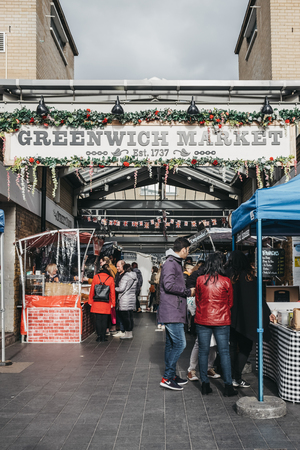 London, UK - March 16. 2019: People at the outdoor market stalls of Greenwich Market, Londons only market set within a World Heritage Site.