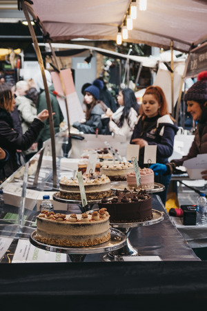 London, UK - March 16. 2019: Different kinds of cakes on sale at a stall in Greenwich Market, Londons only market set within a World Heritage Site.
