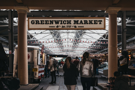 London, UK - March 16. 2019: People entering Greenwich Market, Londons only market set within a World Heritage Site. Selective focus on the foreground. 新聞圖片