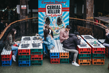 London, UK - March 23, 2019: People at the outdoor tables of Cereal Killer cafe in Camden, London, the Worlds first International Cereal Cafe. Editoriali